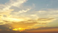 4K/UHD to HD Day to Night Time-lapse : 4K golden vivid heavenly sunset sky timelapse sun beams and light rays. Light lays shining through holes in the golden clouds. video