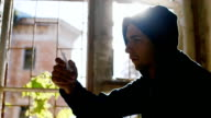 To overcome drug addiction. A young man throws a syringe, sitting at a window in the sun video