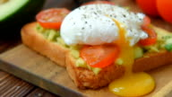 Toast with avocado , egg and tomatoes cooked in olive oil video