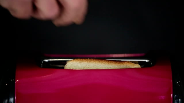 SLOW MOTION: Toasting bread in toaster machine video