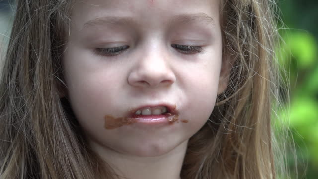 Toddler Girl Eating Chocolate Popsicle video