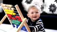 FAST MOTION: Toddler having fun with abacus video