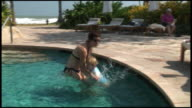 (HD1080) Toddler Jumps Into Mother's Arms in Pool video