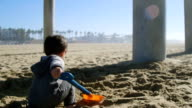 Toddler Playing in Sand video
