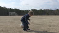 Toddler practicing soccer alone video