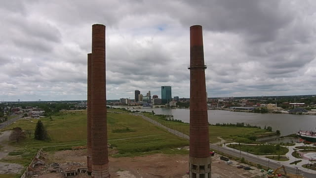 Toledo Ohio Skyline seen through smokestacks video