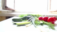 Tomatoes and cucumbers on the table in kitchen video