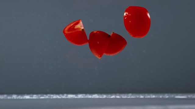 Tomatoes, solanum lycopersicum, Fruits Falling on Water, Slow Motion 4K video