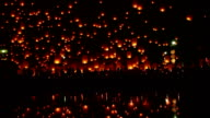 Tons of lanterns across dark sky. video