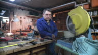 HD DOLLY: Toolmaker Posing In His Workshop video