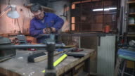 HD DOLLY: Toolmaker Working With Circular Saw video