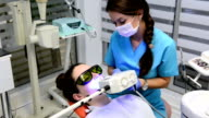 Tooth whitening in dentist office video