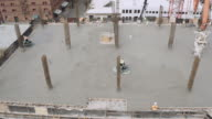 Top floor of construction site being cemented video