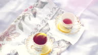 Top of view of Tea cups outdoors at picnic during autumn with sunshine in slowmotion. 1920x1080 video