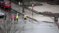Top shot of people running and passing through crosswalk video