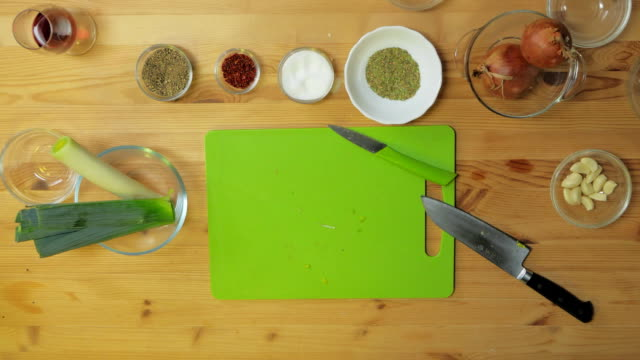 Top view. Chef sprinkling spices on dish in commercial kitchen video