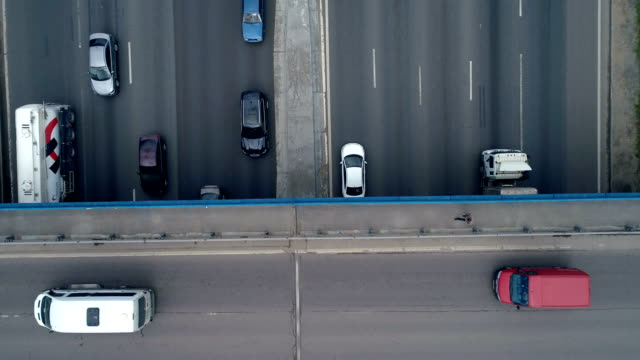 Top view of a road bridge with cars and pedestrians. video