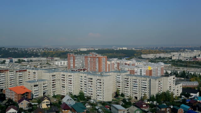 Top view of big city with block of flats outdoors in good day video