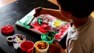 Top view of boy draws paints abstract drawing video