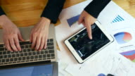 Top view of Business people working onLaptop with Digital Tablet and Chart diagrams video
