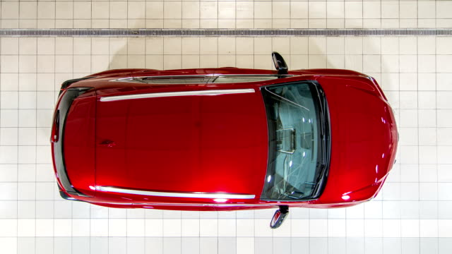 Top view of cars entering to the workshop service station timelapse video