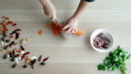 Top View of Chefs Hands Chopping Carrot On Wooden Board, Healthy Food Concept video