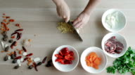Top View of Chefs Hands Chopping Ginger And Garlic On Wooden Board, Healthy Food Concept video