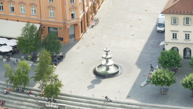 Top view of fountain in Ljubljana downtown, tourists having rest at Town Square video