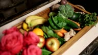 Top view of fresh fruits and vegetable in tray video