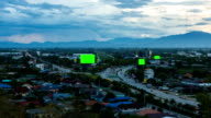 Top view of highway at night with green screen billboard video