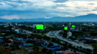 Top view of highway at night with green screen billboard (zoom) video