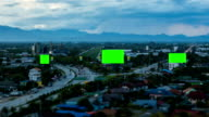 Top view of highway at night with green screen billboard_zoom_tilt-shift video