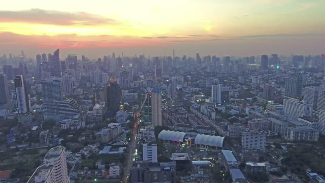 Top view of skyscraper which sunset Golden light though clouds over cityscape Ekkamai video