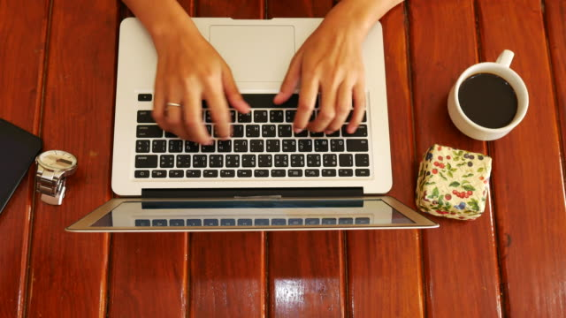Top view of woman hands typing on Laptop video