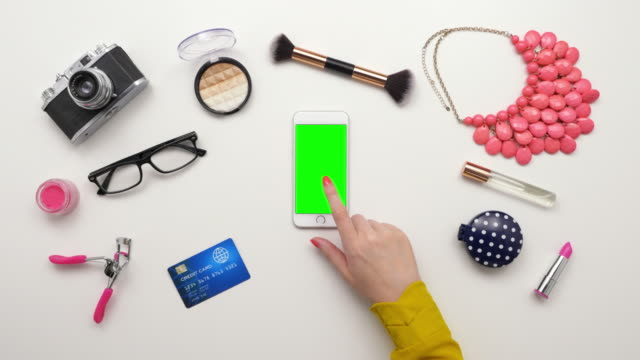 Top View Of Woman Touching Smartphone By Credit Card And Cosmetics video
