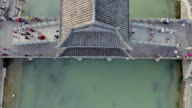 Top View or Aerial Shot of Famous Stone Old Fashioned Chinese Bridge in Ancient Town in Fenghuang County, China. Aerial View of Stone Bridge over Green River, Crowds of People video