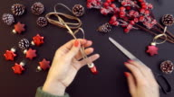 Top view preparing Christmas decoration on the table hands from above. video