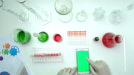 top view scientist using smart phone in laboratory video