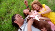 Top view shot of African-American family lying on their backs video