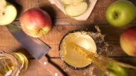 Top view slow motion pours apple juice in a mug video