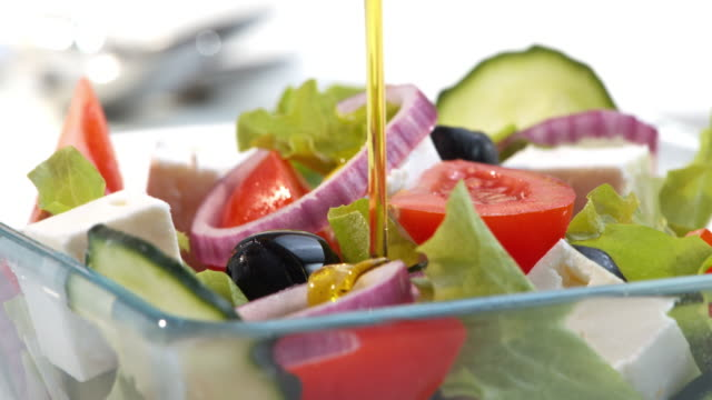 Topping the salad with olive oil video