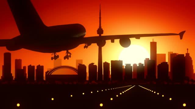 Toronto Canada Airplane Landing Skyline Golden Background video