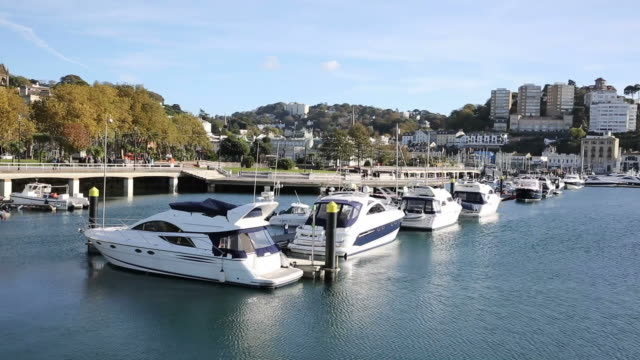 Torquay Devon marina with boats and yachts English tourist town video