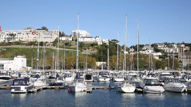 Torquay Devon UK marina with boats and yachts on beautiful day on the English Riviera video
