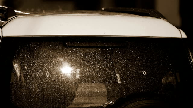 Torrential rain on car surface video