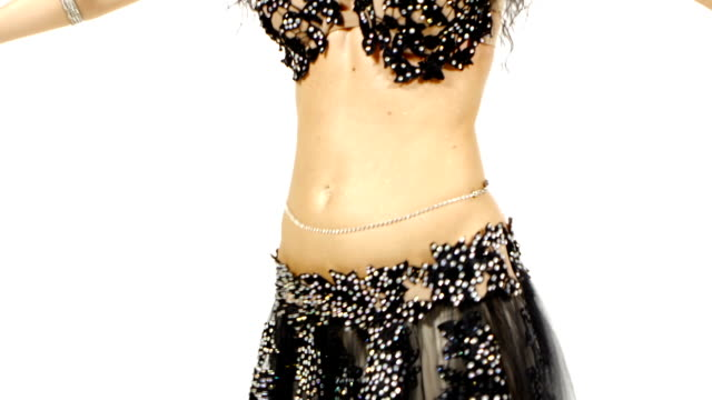 Torso of a exotic female belly dancer who is shaking her hips, on white video