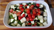 tossing oil with vegetable for roasting video