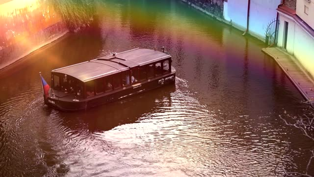 Tour boat with tourists floating on river video