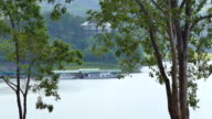 Tourist boats parked in the middle of Lake pan mountains. video