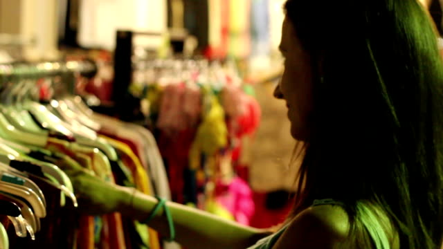 Tourist  Buying Clothes In a Local Shop video